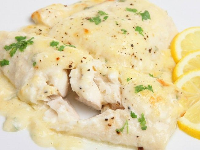 You can use any white fish in this recipe such as cod, flounder, or tilapia. Serve the fish and cheese sauce over rice for an easy crock pot meal. | CDKitchen.com