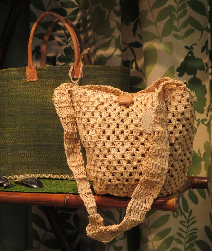 Bag of crochet raffia, button of wood. Basket with outside of woven raffia, inside of plaited reeds, handles of vegetable tanned leather. La Maison Afrique FAIR TRADE stand at Formex August 2013.