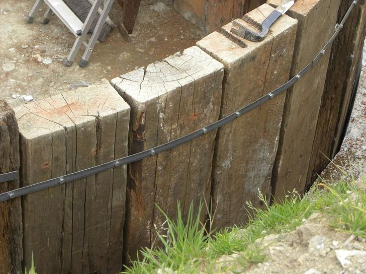 Using upright railway sleepers as a retaining wall This is your chance to grab 100 great products WITH Master Resale Rights for mere pennies on the dollar! http://25-k-firesale.blogspot.com?prod=W6huJo96