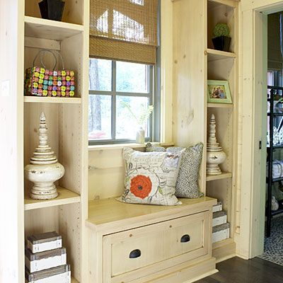 just inside the front door shelves and a window seat offer a place to stash keys purses and tennis shoes
