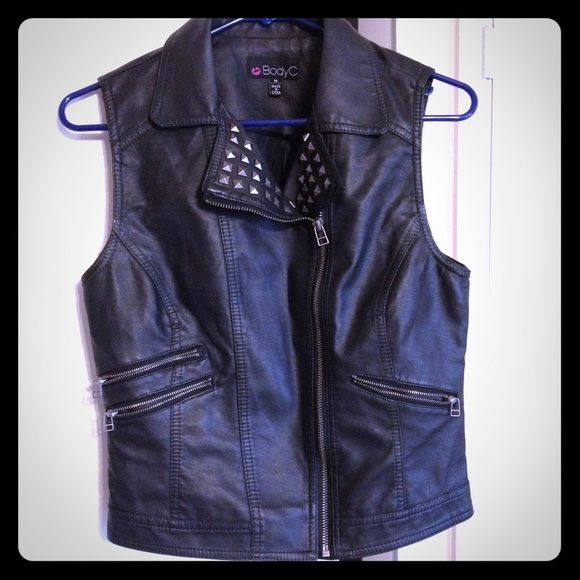 BODY CENTRAL studded vegan leather vest Black vegan leather vest with studded lapels and zippered closure. Two zippered pockets and one zippered mock pocket. Worn TWICE and in perfect condition. Body Central Jackets & Coats