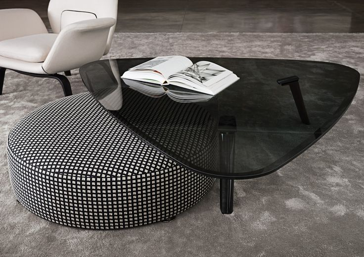 Can decide between a coffee table or an ottoman? Don't choose, do both.