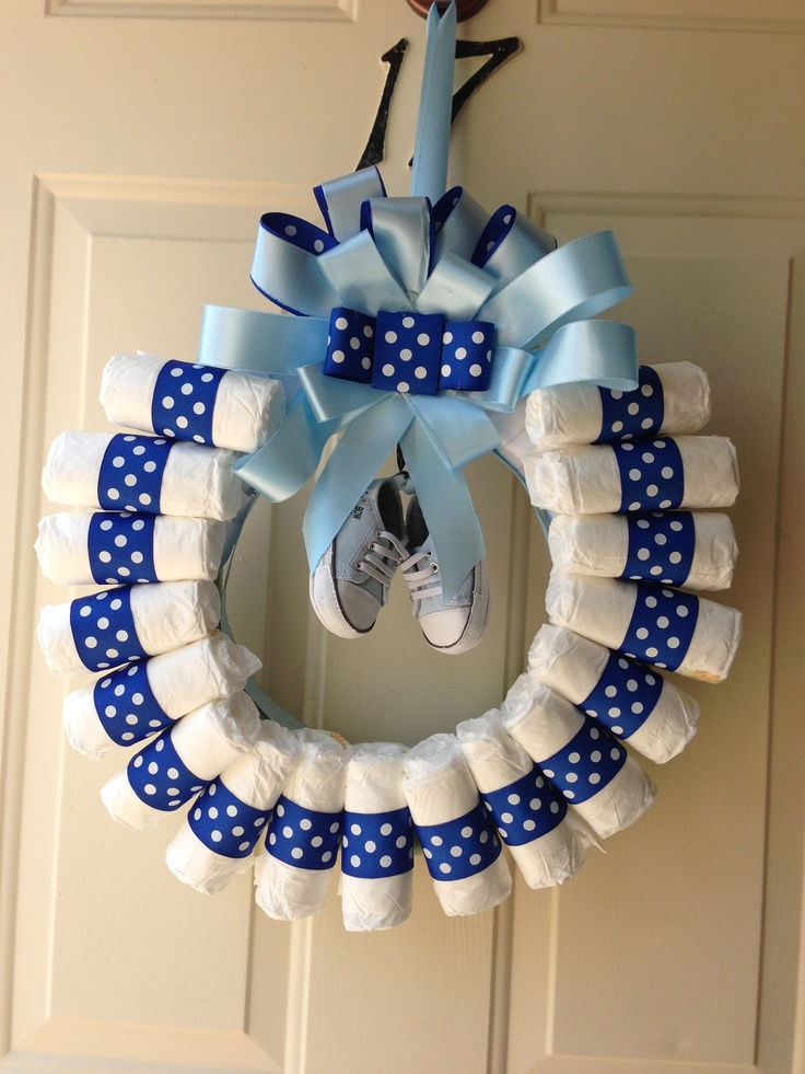Baby shower wreath. Would love to hang this on the door but alas it's a surprise party and this might give it all away.