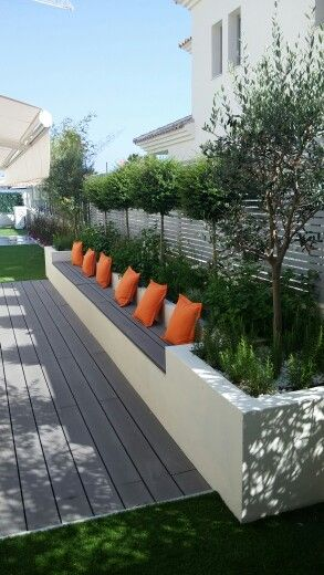Seating feature inset to raised planter