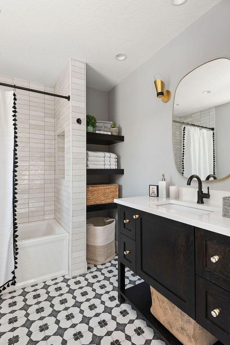 the bathroom boasts a gorgeous patterned floor a tonal