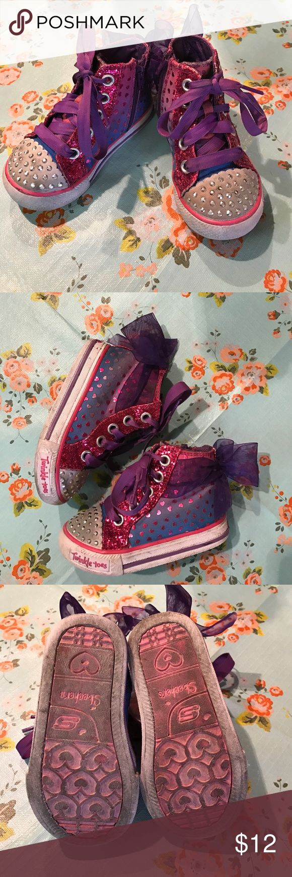 Skechers Twinkle Toes Cute shoes. Show signs of wear, but the zippers and laces and lights are still in good condition. Great for the kid hat outgrows their shoes in a few months, like most toddlers do! Skechers Shoes Sneakers