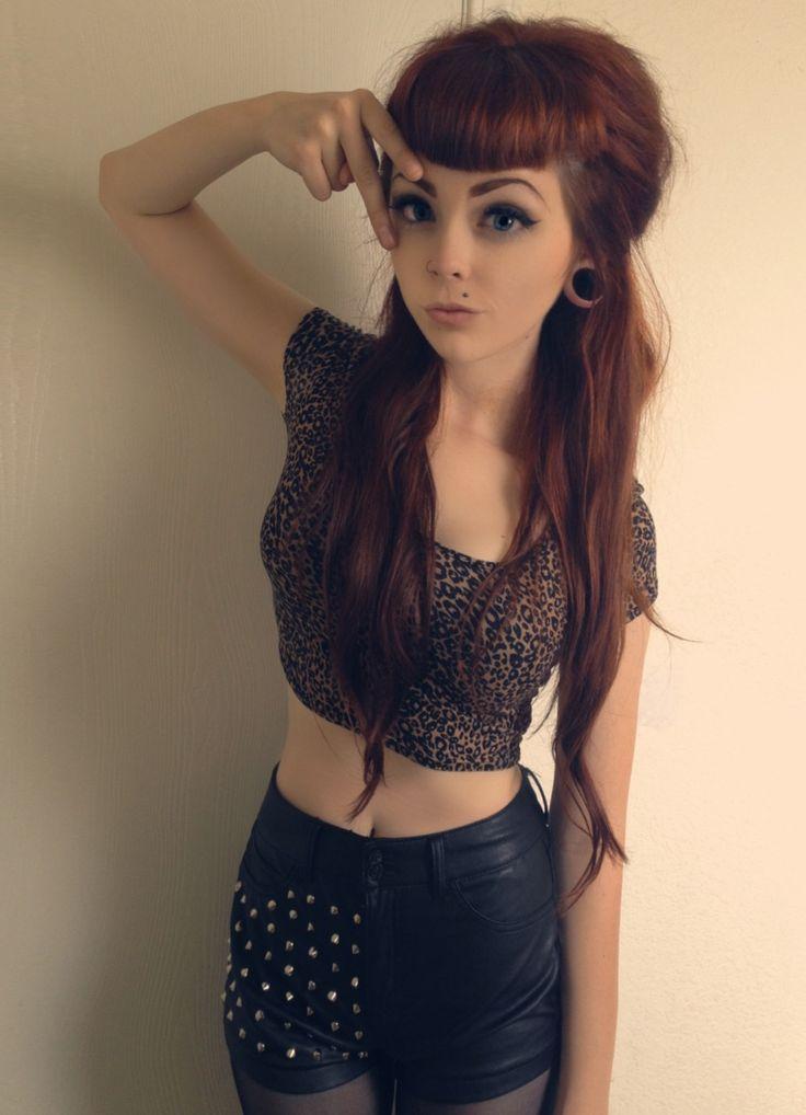 Bangs, half up hairdo and long hair. Piercings. Cute look!