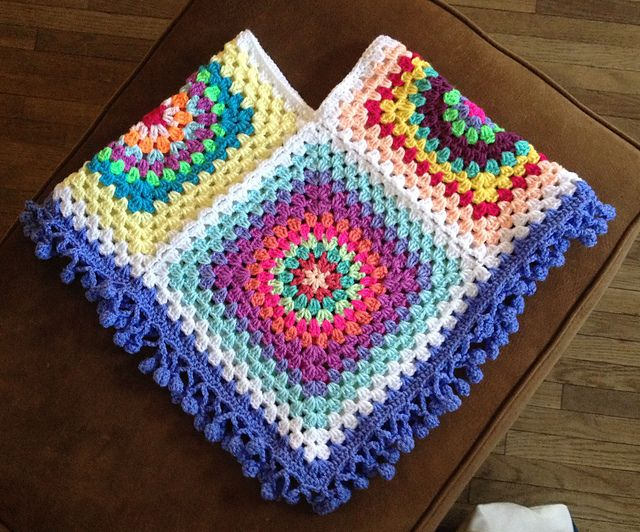 granny square poncho, 4 big squares, 11 rounds with dk yarn joined with join as you go method with a dc border and bobble trim