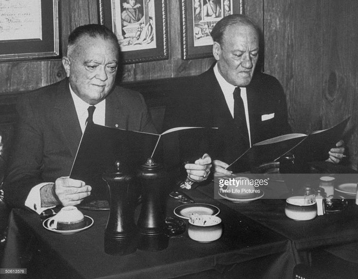 J. Edgar Hoover and his asst. Clyde Tolson looking at menus