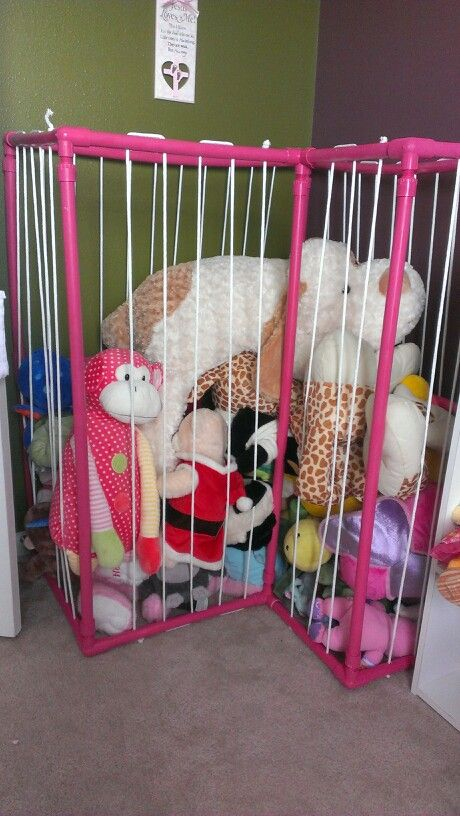 """Stuffed Animal Zoo"" - made out of pvc pipe and clothesline rope."