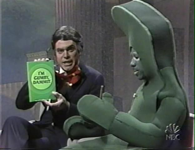 Tom Snyder (Joe Piscopo) interviews cigar-chomping cartoon legend Gumby (Eddie Murphy), who has a new tell-all book. Description from bendouwsma.com. I searched for this on bing.com/images