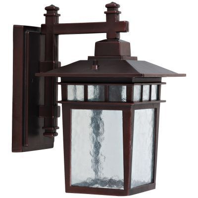 Dante by Yosemite Home Decor has a square box shape adding a bit of modern influence yet the frame is much more traditional. The Incandescent bulb is protected by the piece's beautifully water glass  allowing a soft light to flood your walkway. This fixture requires one 60-watt Incandescent bulb (not included).