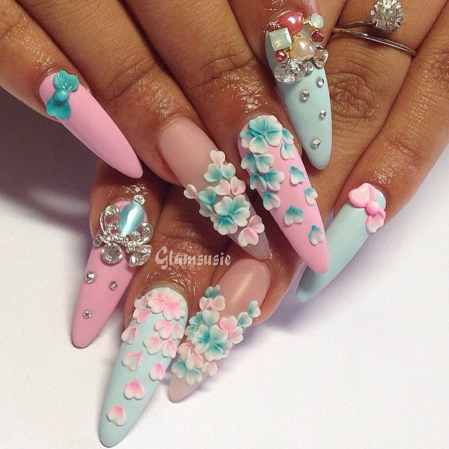 Love the delicate little flower accents.. especially the ring fingers. // Pale blue and pink stilettos with 3-D design