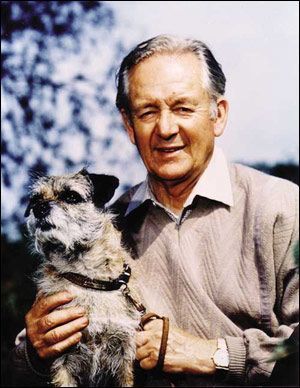 Author James Herriott (All Creatures Great and Small) with his own Border Terrier