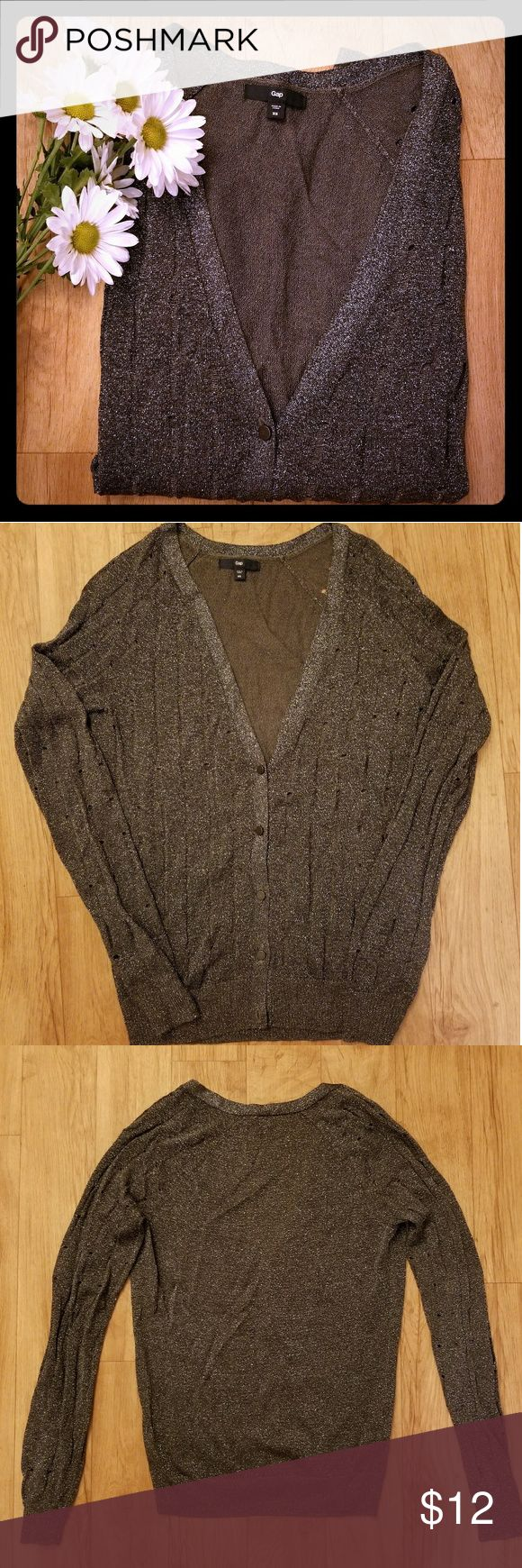 Gap Sheer and shimmering grey and silver cardigan Sheer cardigan with shimmering sparkles. Has holes in it but this is the style of it. Color is a Dark grey with silver. No longer fits me. Size is an XS. Very thin and more like a knit top and not so much a sweater. Still in great condition and was not worn that many times. GAP Sweaters Cardigans