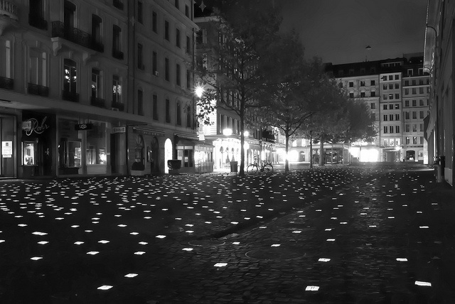 Doesn't it just make you happy?  (Lighted cobblestone paving, Place du Molard by Papagueno, via Flickr)