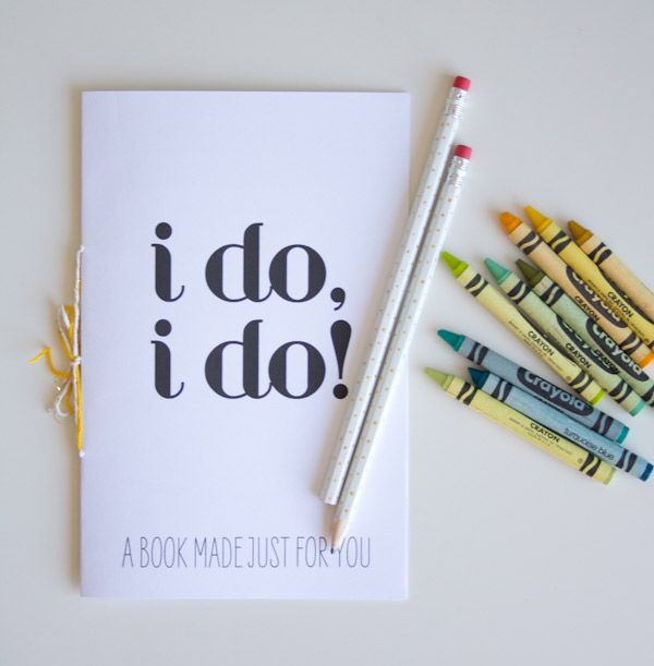 This Printable Wedding Activity Book is perfect for the kids table!! Ill do the little booklet, a packet of crayons and a little burlap sack with candy in it.