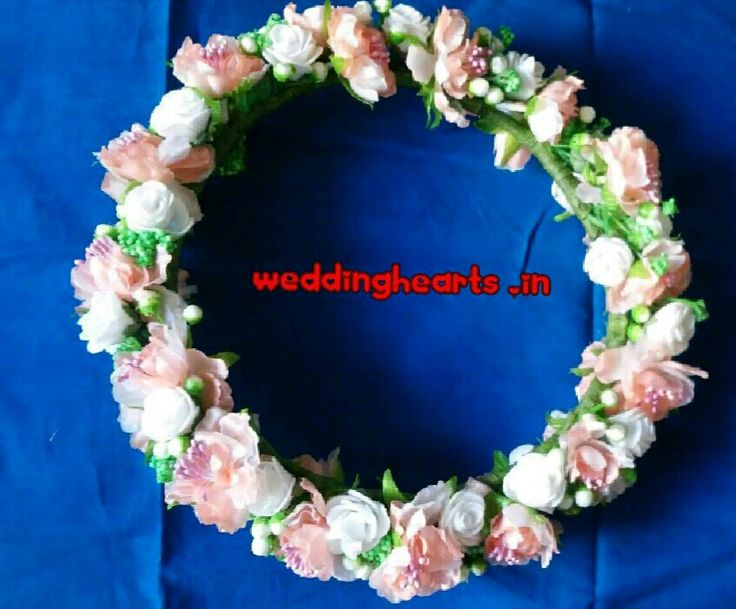 Bridal Tiara/Tiara/ Headbands. Code: WH FT 001.Beautifully woven and handmade with artificial flowers.Look Gorgeous and stunning wearing these tiaras and make occasions special.Customised and personalised according to the matching colour of the outfits/ wedding wear.Price Rs1500 Each.Bulk orders also taken.