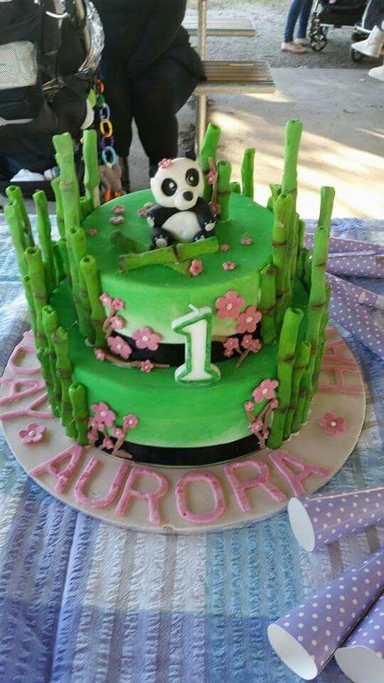 Panda birthday cake. Bottom tier: dark chocolate mud cake, covered in chocolate ganache.  Top tier: white chocolate mud cake covered in white chocolate ganache.