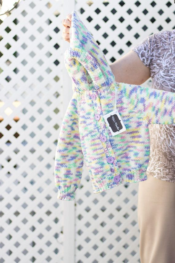 This Unicorn theme colored hand knitted sweater is one of a kind, just like all our products! Each sweater is made with special variations that make it uniquely yours, while still maintaining the qualities that make it a functional garment such as a hood, cozy long sleeves, and