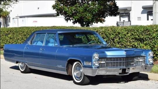1966 Cadillac Fleetwood, with fold-down footrests, illuminated writing tables, and real chunks of wood trim.  This one also has front headrests, which I'm sure are correct.