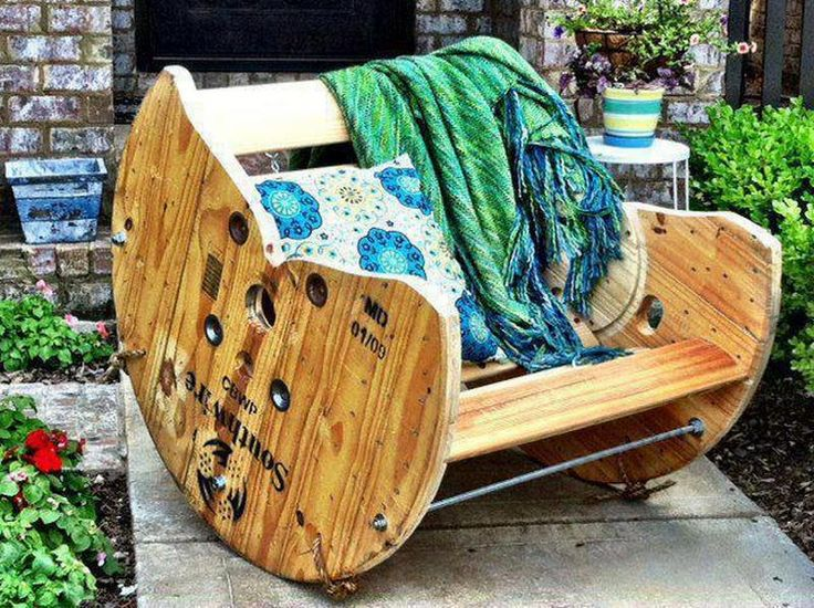An old wooden reel, upcycled into a comfortable rocking chair. I have been looking for a great idea like this to use my HUGE spool!