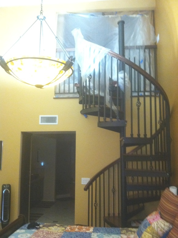 """spiral staircase leading to """"loft closet"""" above the master bedroom"""