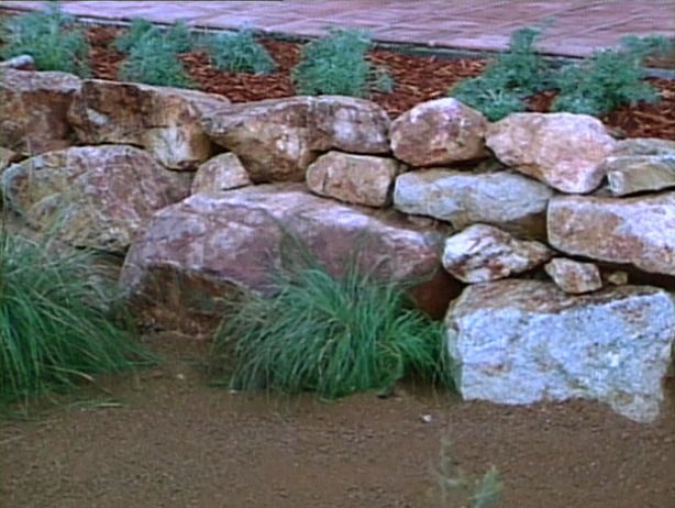 Large Boulder Retaining Walls | How to Build a Boulder Retaining Wall : How-To : DIY Network