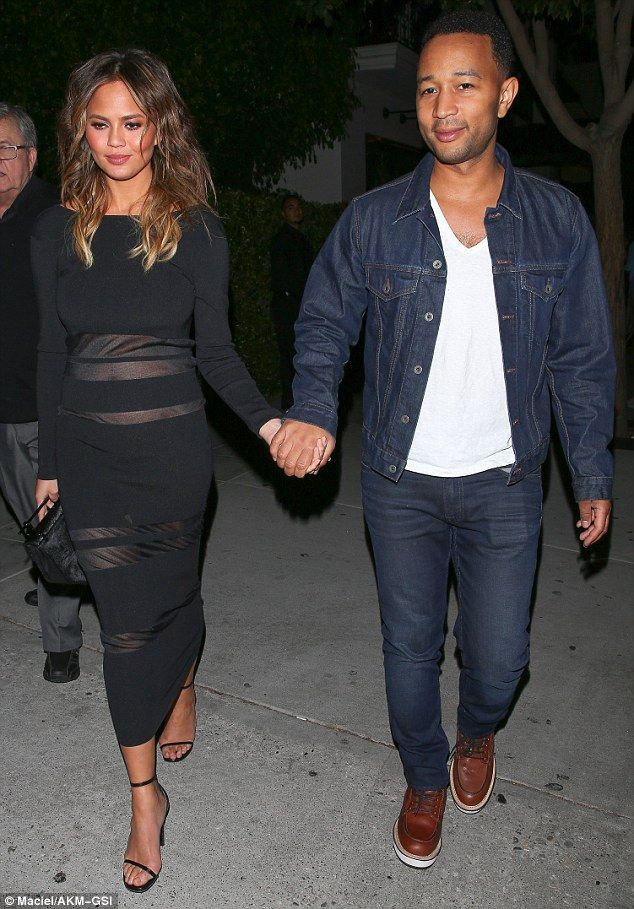 Ripping up the rule book: Pregnant Chrissy Teigen proudly paraded her neat baby bump in a ...