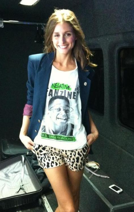 Olivia Palermo wearing Tibi Cheetah Shorts.