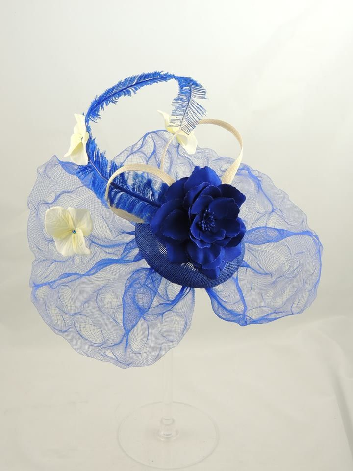 Cobalt blue button headpiece circled by distressed crin, Ivory loops and hydrangea petals