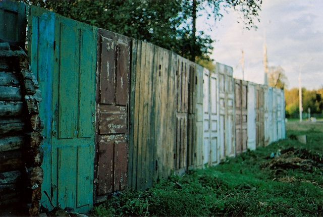 Love this fence made of old doors!