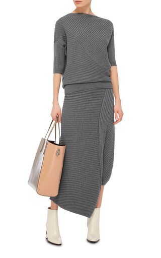 This **J.W. Anderson** sweater is crafted from a merino wool blend with diagonal ribbed panels.