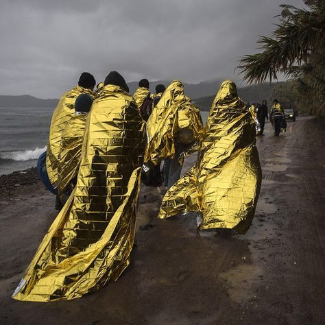 Refugees and migrants are cover themselves with thermal blankets after their arrival on a dinghy from the Turkish coast to the village of Skala Sykaminias on the northeastern Greek island of Lesbos. The International Office for Migration says over the last week Greece experienced the largest single weekly influx of migrants and refugees in 2015 at an average of some 9600 per day. #APPhoto by @santipalacios  The Atlanta Photojournalism Seminar (@atlantaseminar) announced results this week…