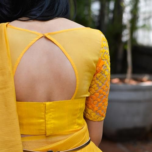 DESCRIPTION: Classic yet quirky, a sunshine yellow blouse which combines three fabrics in the same colourFABRIC:Body - Yellow raw silkYoke - Yellow chiffonSleeves - Yellow