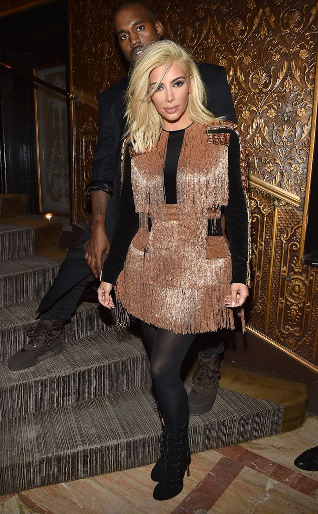 Kim Kardashian & Kanye West from Stars at Paris Fashion Week Fall 2015  The ever fashion-forward pair makes an appearance at the Balmain Aftershow Dinner.