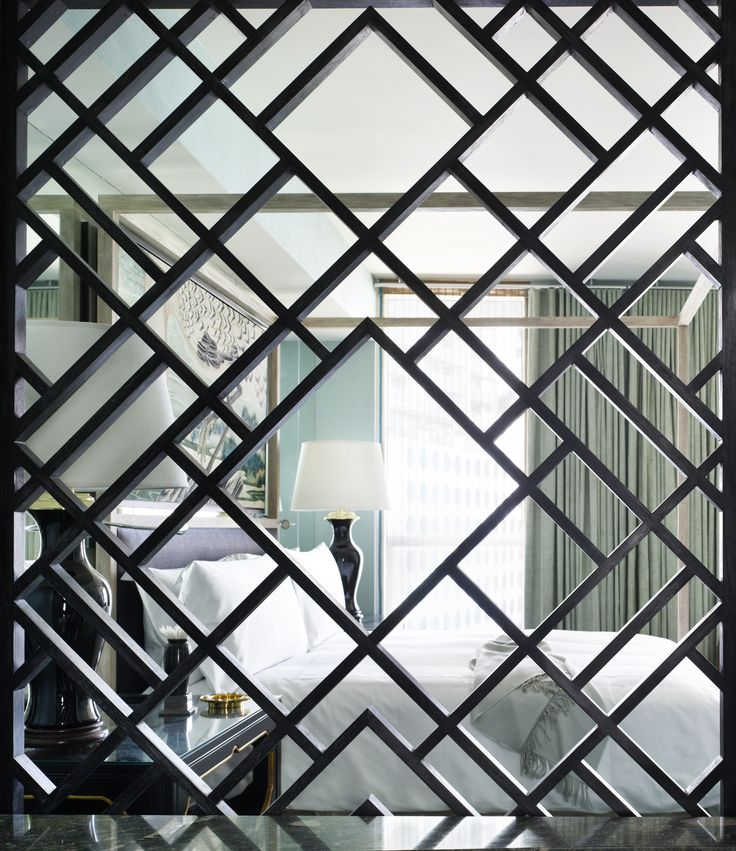 A geometrical screen divides the bedroom and bathroom at Viceroy MGeometric wall screen