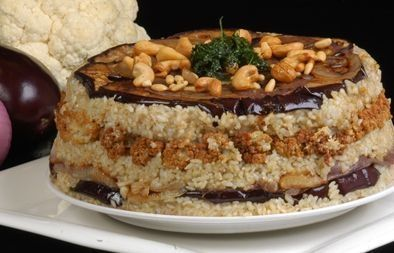 Maklouba: vegetable upside-down dish. Usually made with cauliflower and eggplant and garnished with fried pine nuts - مقلوبة