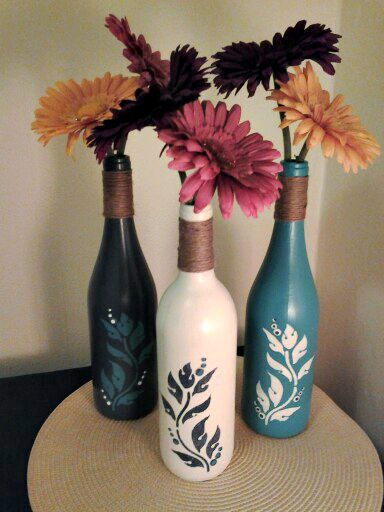 STENCILED STYLE Another easy way to paint up a bottle with style is stencils. There are endless options for patterns and try adding some twine around the bottleneck, as shown below, for some added texture.