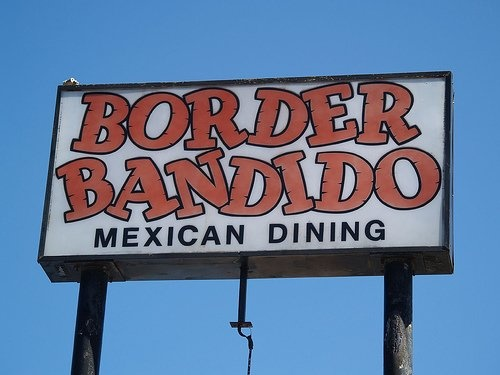 Border Bandido has been a fixture in Lawrence, Kansas since I was a teenager.  The Texas Burrito is their signature menu item, but their tacos and enchiladas are also good.  It started as the Chili Bowl; then it was Don Chilito's Border Restaurant.  When I was a kid, there was a juke box near the door.  It's gone now, but the tasty food and friendly service remain.    Google Image Result for http://s3-media3.ak.yelpcdn.com/bphoto/lLLEcJLmZ3UFAcm_MTXkjQ/l.jpg