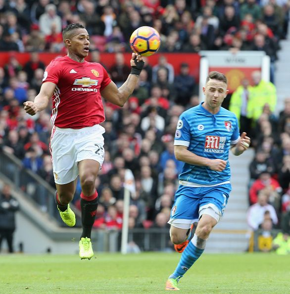 Antonio Valencia of Manchester United in action with Marc Pugh of AFC Bournemouth during the Premier League match between Manchester United and AFC...