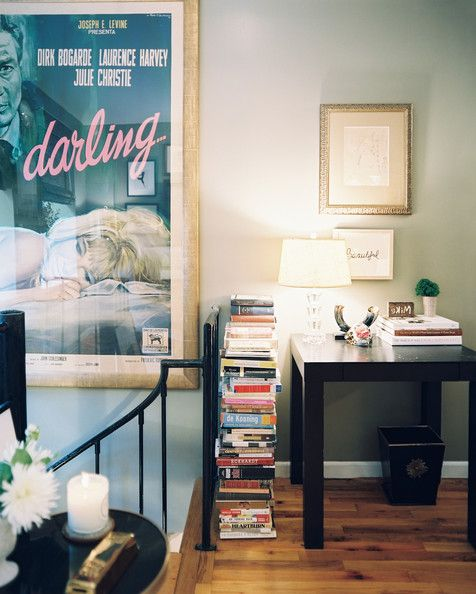 Awesome Bachelorette Pad - A stack of books beside a petite black desk