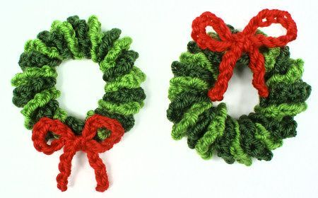 "© June Gilbank 2013 <br /> <br />This sweet little pattern lets you make surprisingly realistic leafy miniature wreaths - at only 3"" across, they'd be perfect as Christmas Tree ornaments or seasonal decorations. A Mini Wreath works up ..."