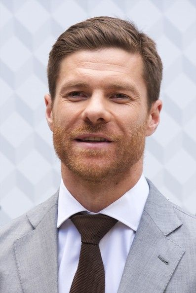 Xabi Alonso Photos Photos - Real Madrid player Xavi Alonso presents the new  Emidio Tucci collection at Casa de America on  on April 3, 2014 in Madrid, Spain. - Emidio Tucci New Collection Presentation