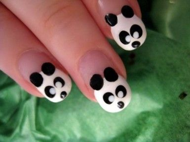 Okay, so these nails = super easy! All you need is a dotting tool to make all of the necessary dots on these panda bear nails! In order to make a dotting tool, just bend back a bobby pin and use its' round ball point to make your dots! Enjoy! :)