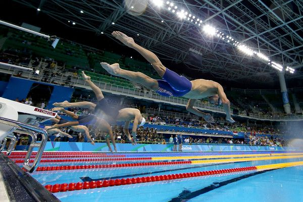 Michael Phelps Photos Photos - Michael Phelps (R) of the United States competes in the second Semifinal of the Men's 200m Butterfly on Day 3 of the Rio 2016 Olympic Games at the Olympic Aquatics Stadium on August 8, 2016 in Rio de Janeiro, Brazil. - Swimming - Olympics: Day 3