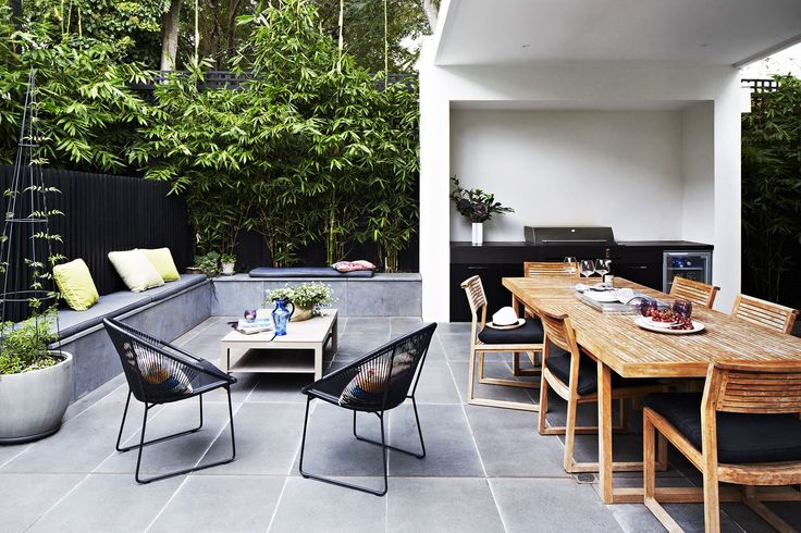 """This elegant alfresco area offers a prime spot for entertaining. """"We seated 26 people here for Christmas without feeling remotely cramped,"""" says Kylie. Bench seating, movable chairs and the well proportioned dining table mean this outdoor entertaining area is ready to host whatever the occasion. Australian House & Garden"""