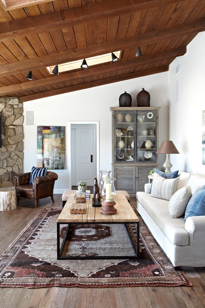 Appealing Hollywood Regency Coffee Table Decorating Ideas in Living Room Traditional design ideas with Appealing china cabinet exposed beams raked ceiling skylight sloped ceiling stone track lighting