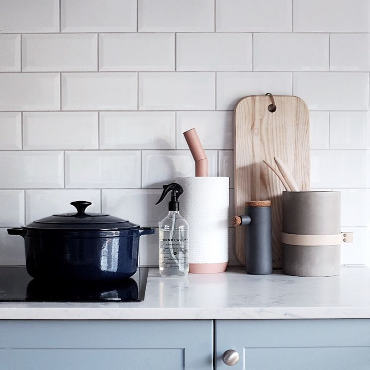 Kitchen inspo: Subway tiles, Bondi Wash bench spray, HAY Porter for kitchen paper towels and wrap me concrete vase used as a utensil holder.
