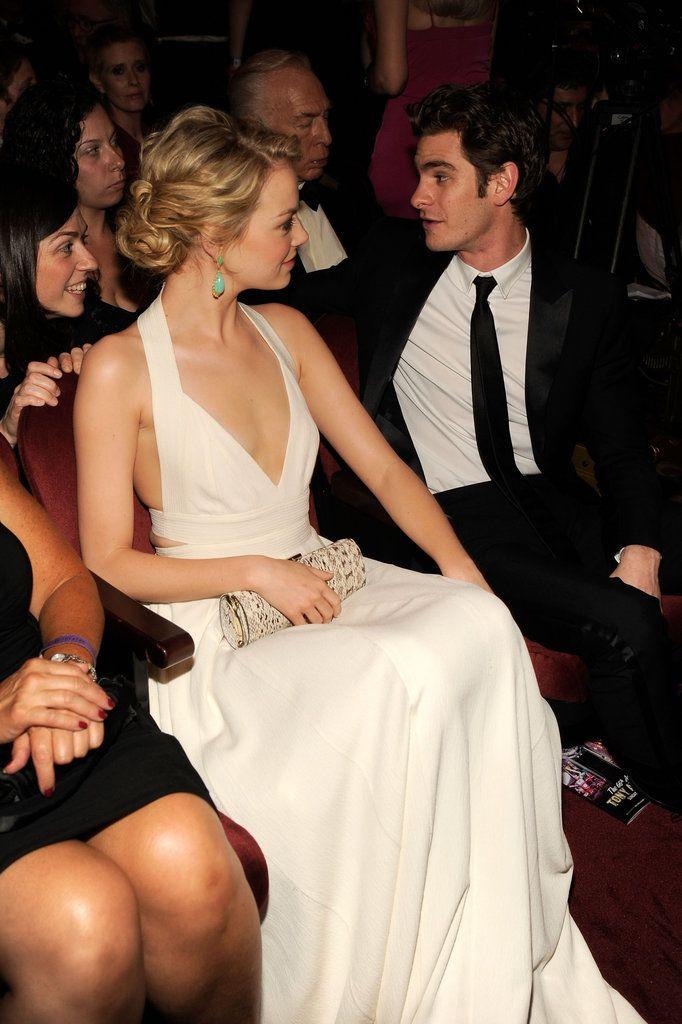Emma Stone, white dress and green drop earrings